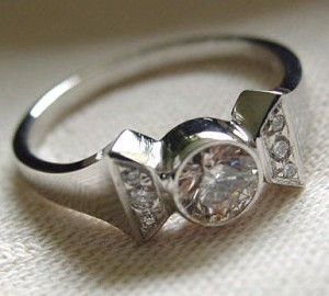 The White Gold Horseshoe Nail Ring shown features .55 cwt of diamonds ...